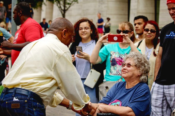 Mayor Sylvester Turner greets parade attendees before getting into his parade SLAB