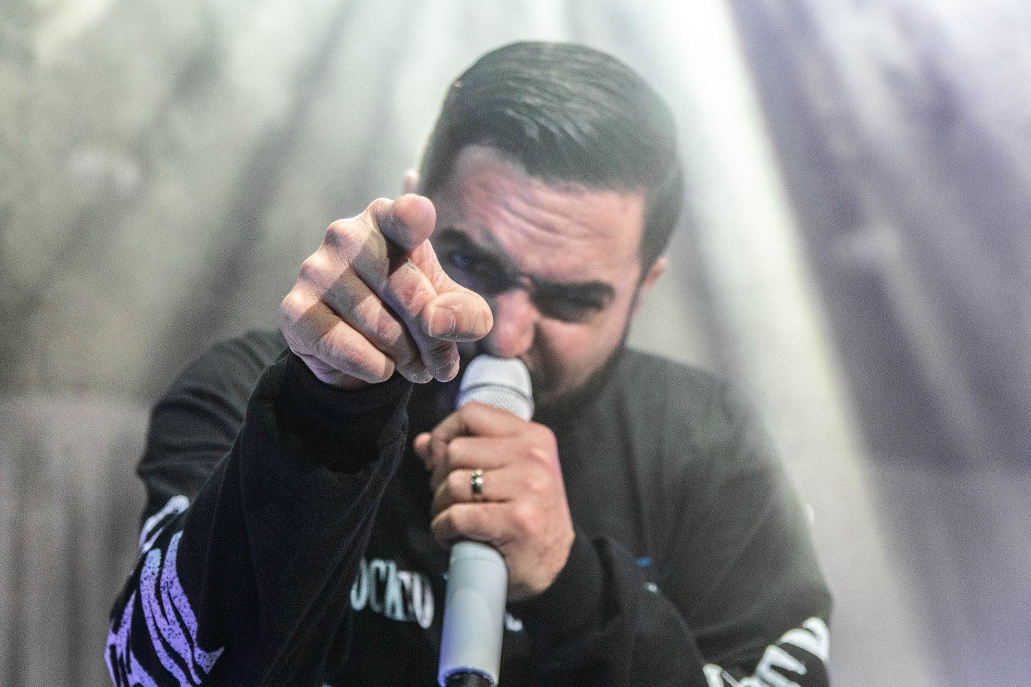 A Day to Remember lead singer Jeremy McKinnon performing at NRG Arena as part of the Degenerates North America Tour