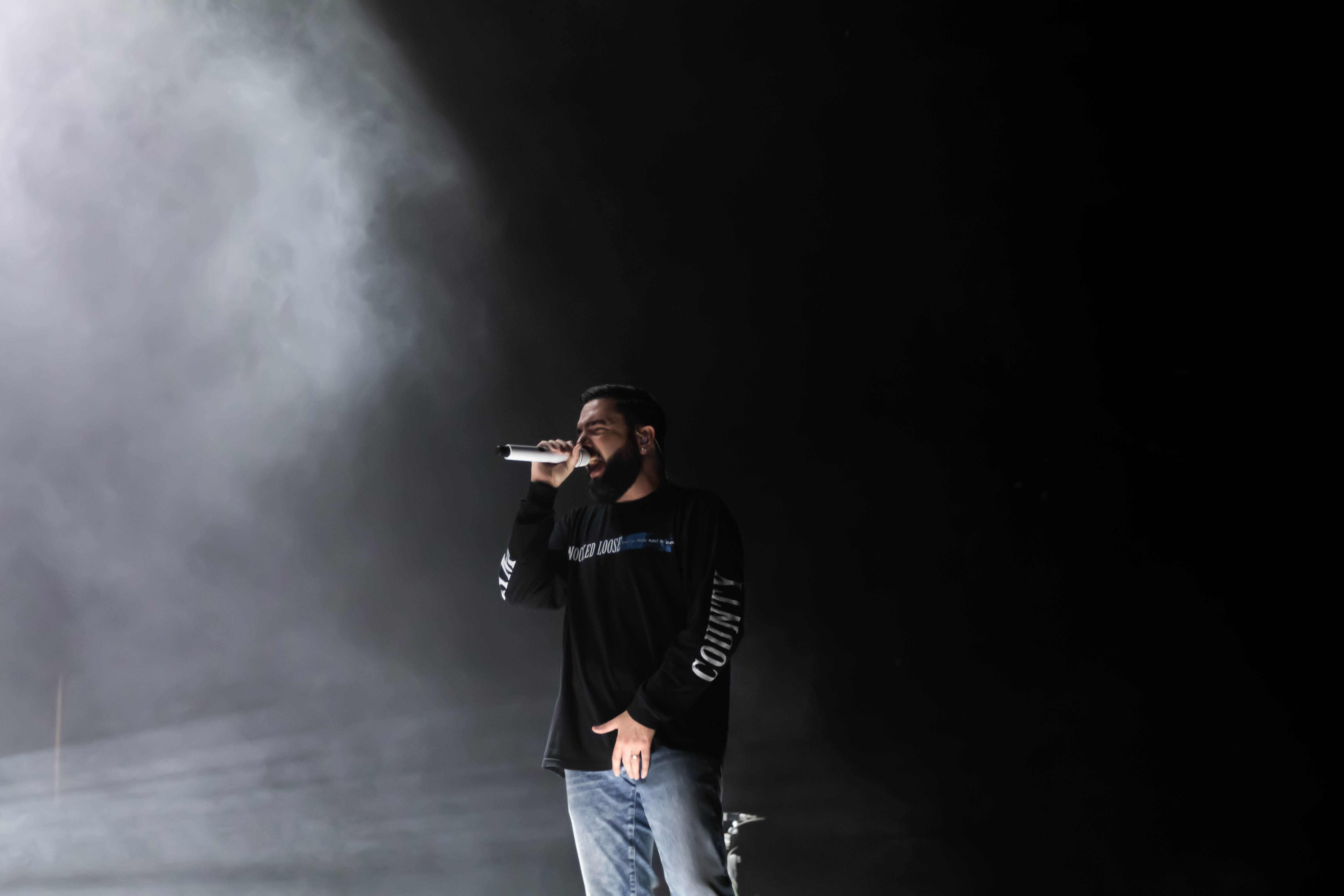 singer Jeremy McKinnon singing into a microphone